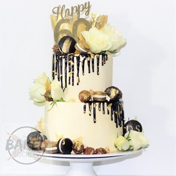 60th birthday two tier cake drup gold macarons